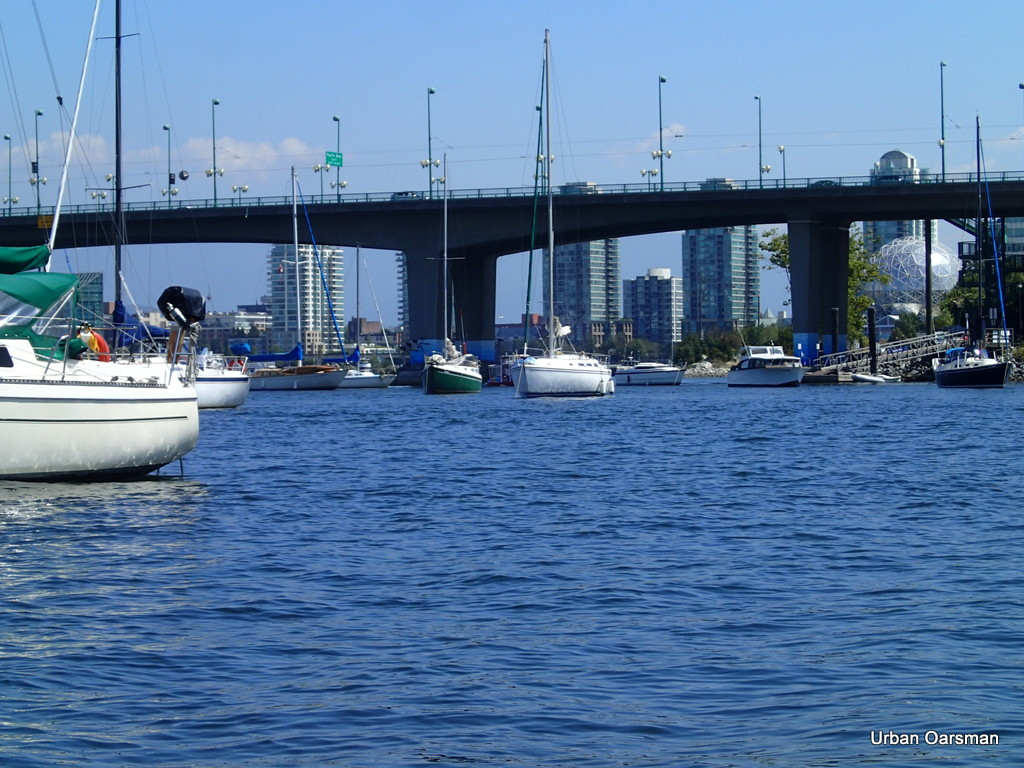 Boats moored in False Creek, Cambie Street Bridge