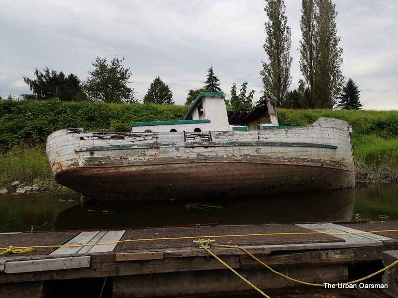 Side view of the abandoned boat.